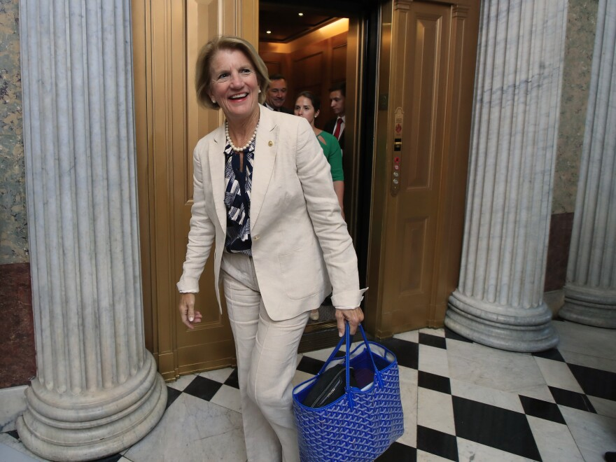 Sen. Shelley Moore Capito, R-W.Va., walks toward the Senate floor on Capitol Hill in Washington on Monday.