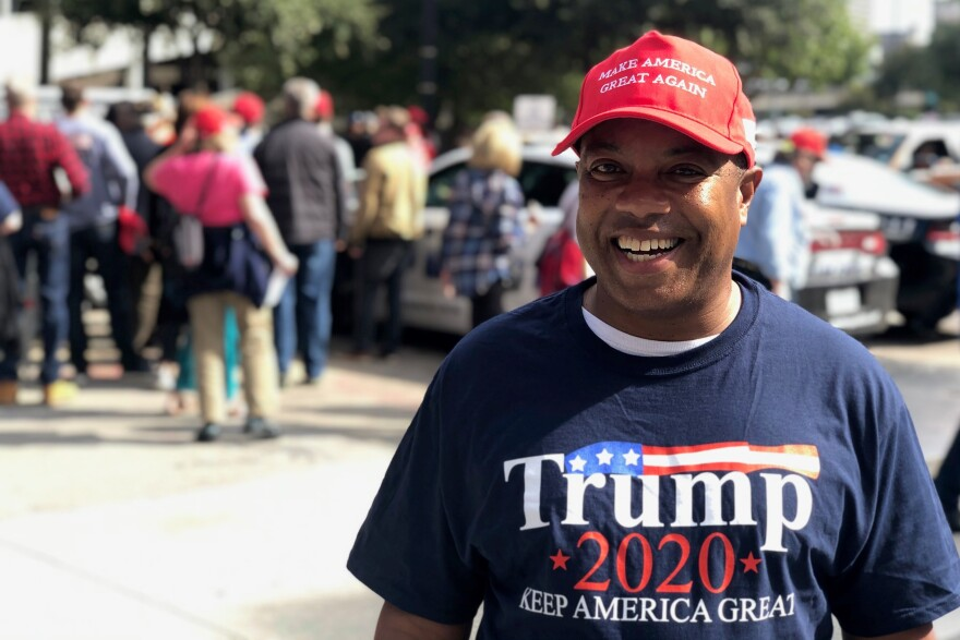 Johnathan Hale is wearing a Trump 2020 shirt and Make America Great Again hat