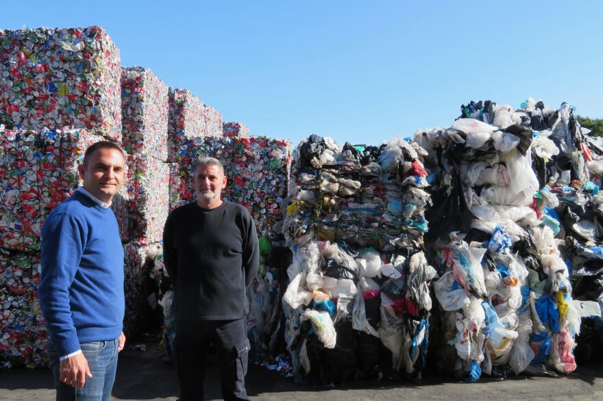 "Kostas Verganelakis (left), COO of the private waste management company WATT, and company shift manager Giorgos Koumantakis. Located outside Athens, WATT receives about 250 metric tons of waste from recycling bins every day. ""If our plant was not here, then all this waste could go to the landfill,"" Verganelakis says."