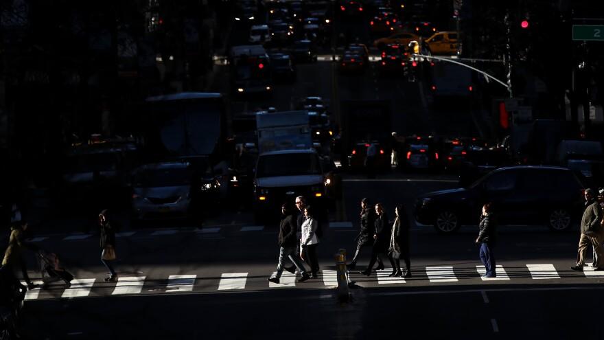 Pedestrians cross the street as traffic moves along 42nd Street in Midtown Manhattan on Jan. 25.