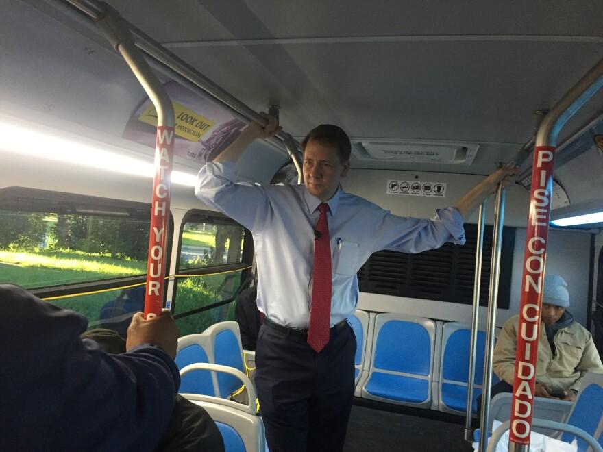 photo of Richard Cordray on bus
