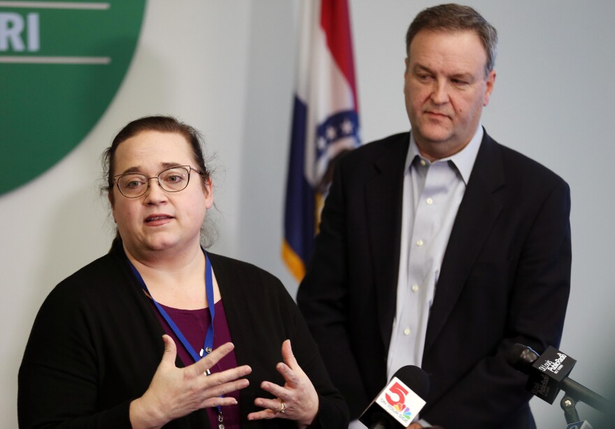 St. Louis County Health Department co-director Spring Schmidt (left) and county executive Sam Page address reporters on Sunday, March 8, 2020, regarding Missouri's presumed first case of the new coronavirus.