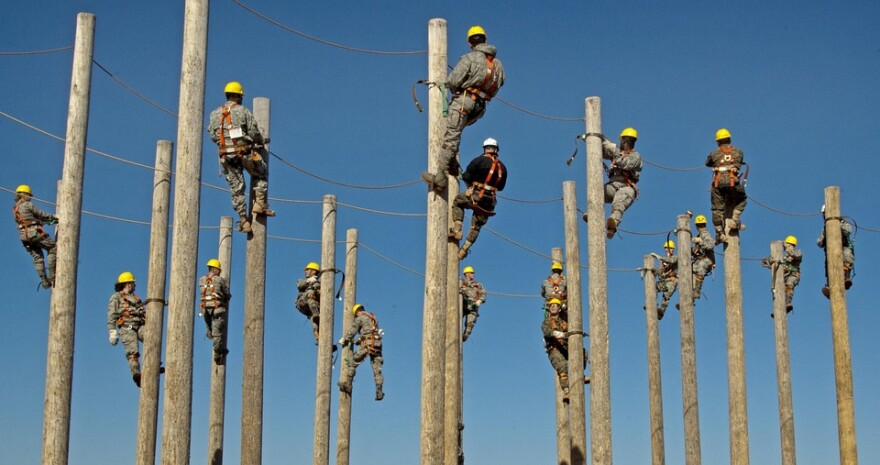 workers_climbing_telephone_poles_training.jpg
