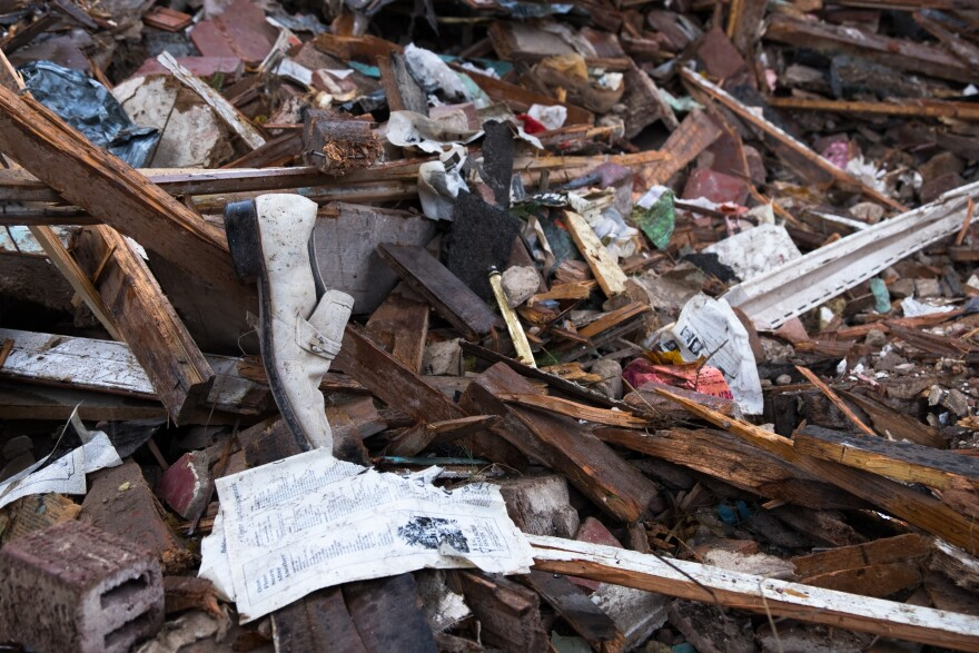 The flood water swept up everything it could reach, leaving damage homes and debris in its wake.