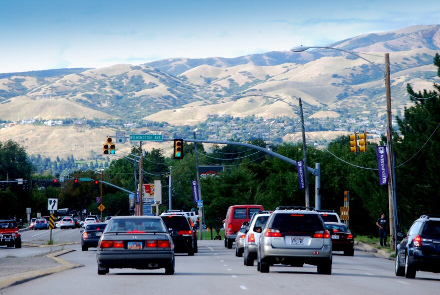 Heavy traffic driving in Salt Lake City with foothills in the background.