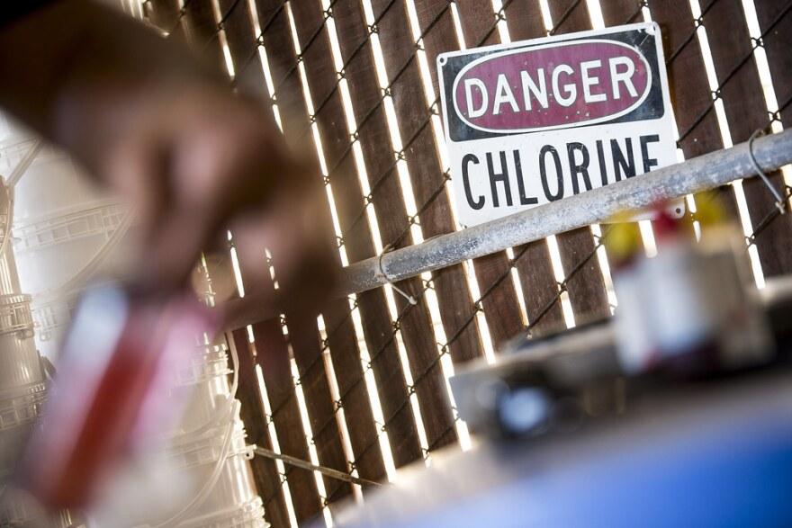 A technician checks chlorine levels in Walnut Creek Pool.