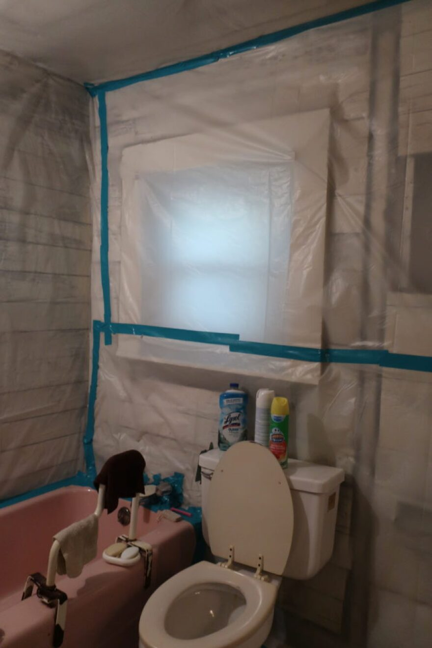 Bathroom covered with plastic.