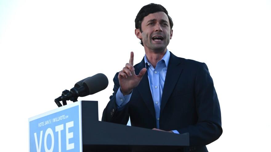 Democrat Jon Ossoff speaks at a rally outside of Center Parc Stadium in Atlanta on Monday.