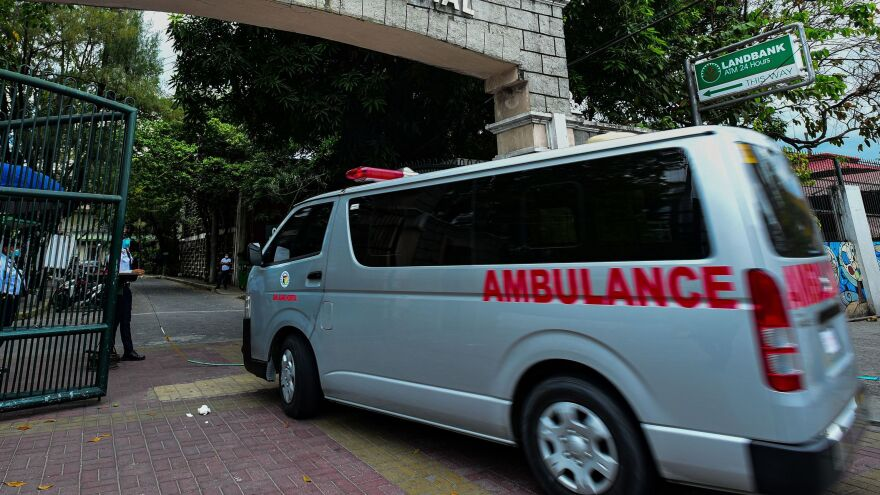 An ambulance enters the main gates of the San Lazaro Hospital in Manila on Feb. 2. Doctors have been especially hard-hit by COVID-19 in the Philippines.