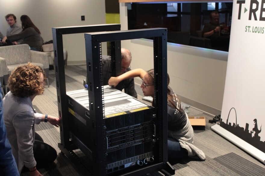 AT&T employees and T-REX members put together server stacks for the AT&T Open Source Lab at T-REX.