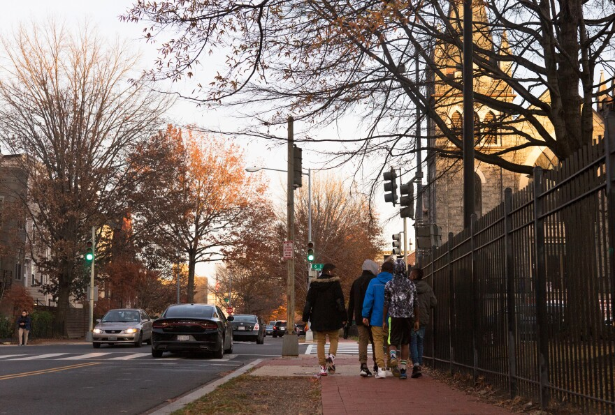 Kids walk home from school by Springfield Baptist Church in Shaw.