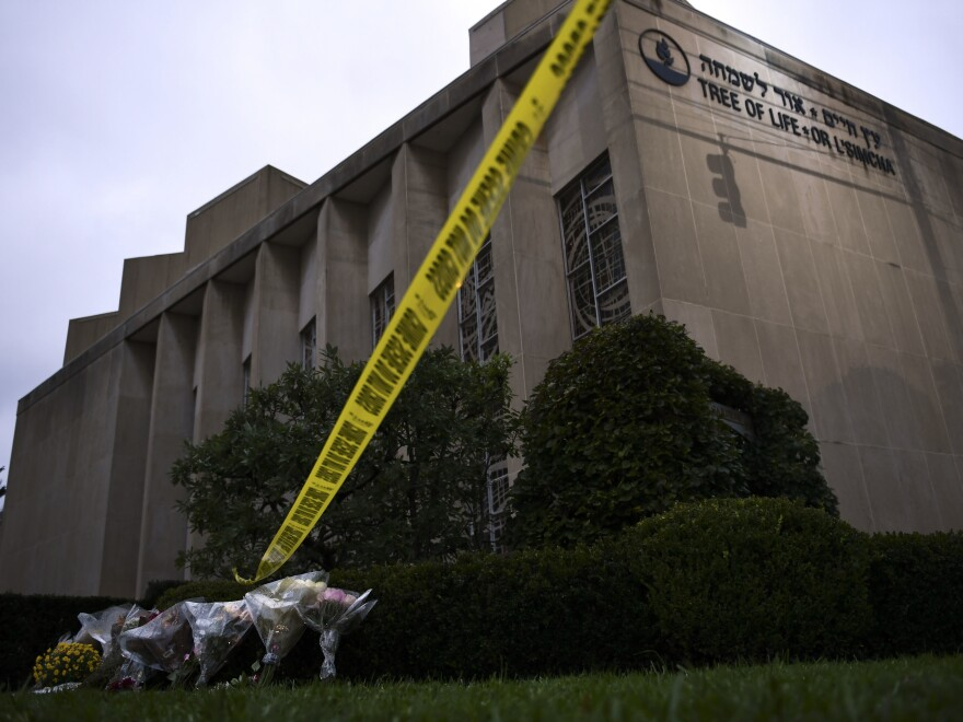 Police tape and memorial flowers are seen on Oct. 28, 2018, outside the Tree of Life Synagogue in Pittsburgh, Pa.