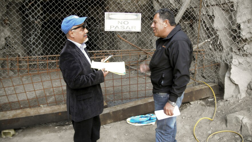 Hector Tobar (left) stands in front of a mine entrance with Luis Urzua, the head of the shift of trapped miners, in 2011 at the San Jose Mine.