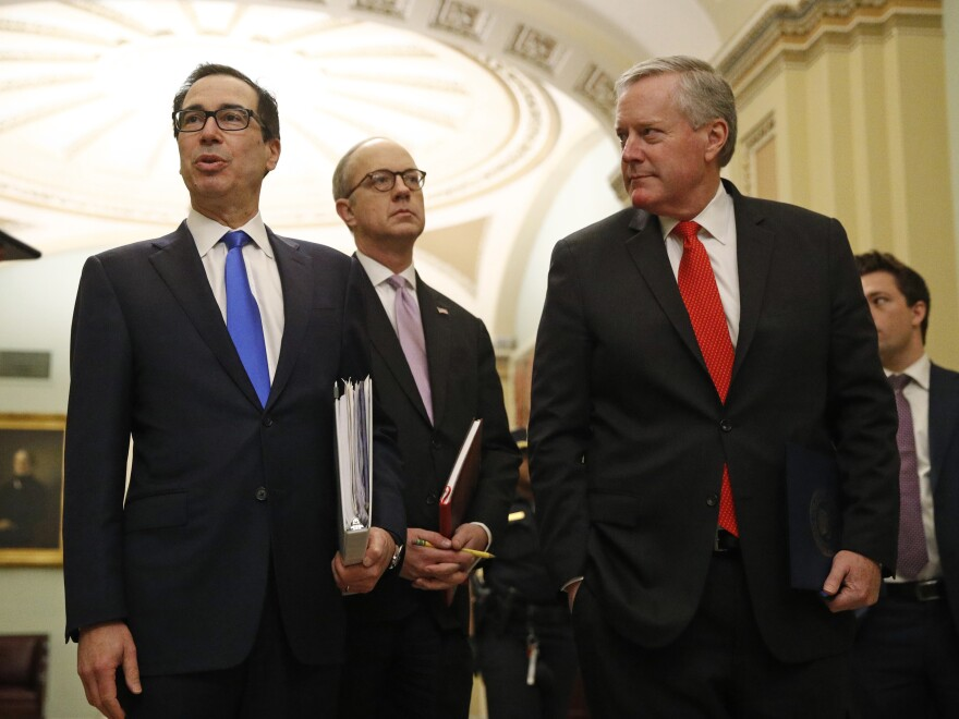 Incoming White House chief of staff Mark Meadows (right) walks with Treasury Secretary Steven Mnuchin and  White House Legislative Affairs Director Eric Ueland on Capitol Hill on Tuesday.