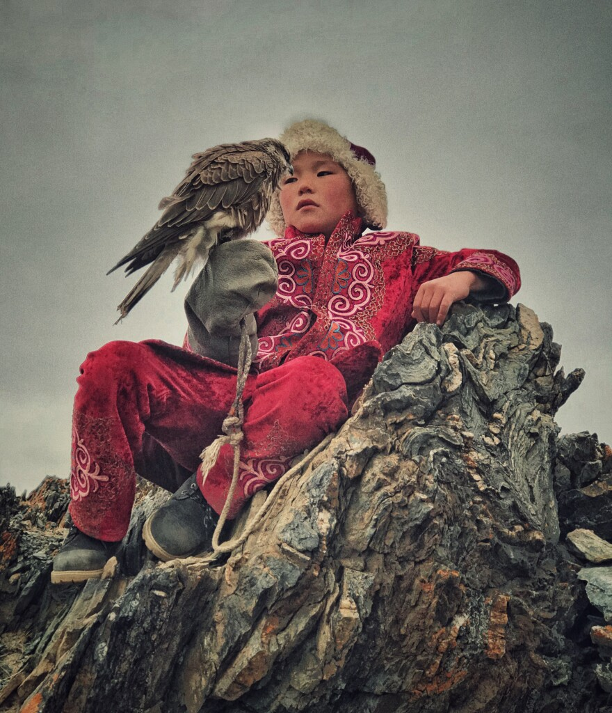 A boy with his hunting bird in Bayan Ulgi province, Mongolia.