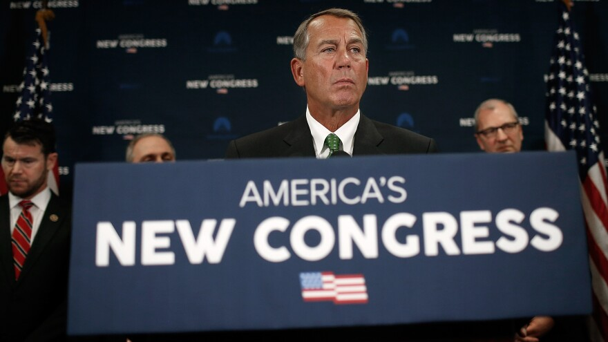House Speaker John Boehner answers questions during a press conference at the U.S. Capitol Wednesday. The House is debating changes to the Affordable Care Act's employer mandate.