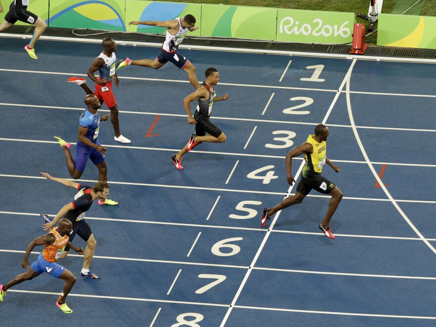 Usain Bolt celebrates after crossing the line to win the gold medal in the men's 200-meter final at the 2016 Summer Olympics at the Olympic stadium in Rio de Janeiro, Brazil.