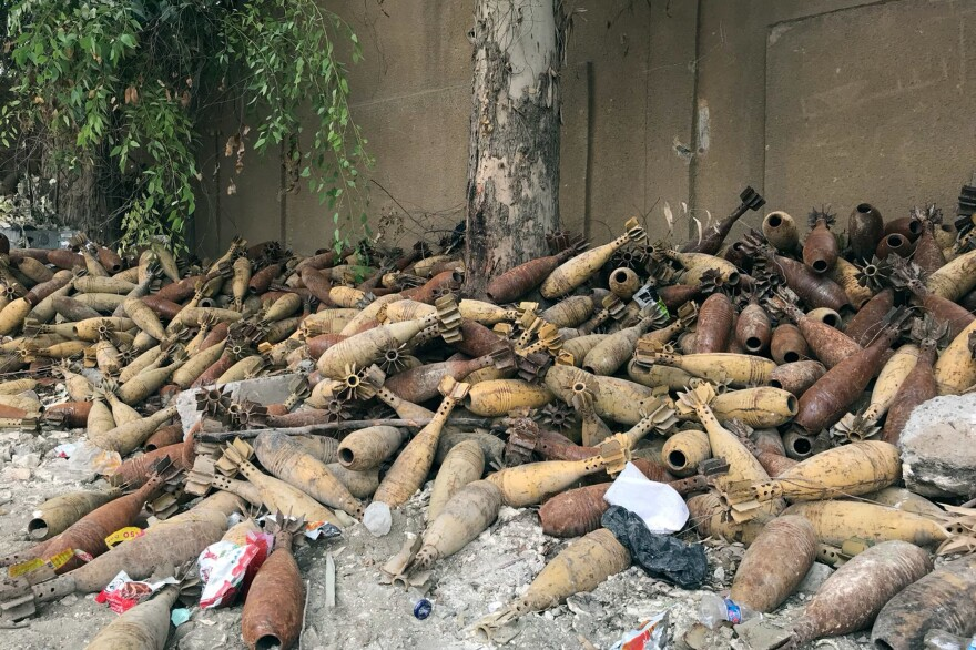 Mortar shells are piled up in the back of a school playground in Raqqa, Syria.