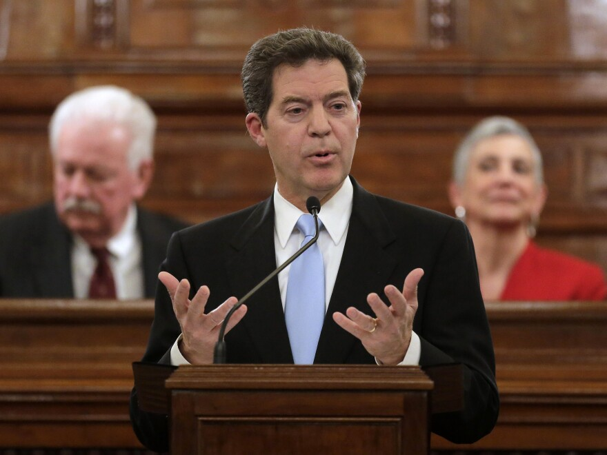 Kansas Gov. Sam Brownback, shown delivering the State of the State address last month, is pushing to get rid of the state's income tax, which has some Republicans concerned.