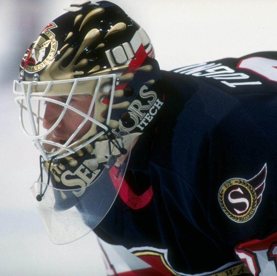 Ron Tugnutt, seen here playing for the Ottawa Senators in 1997, says he got the idea for a splash design a few years earlier while playing for the Montreal Canadiens, which was owned by the Molson family. For that reason the original idea was to mimic beer, but he continued to use the splash design (with new colors) for each of the teams he went on to play for.