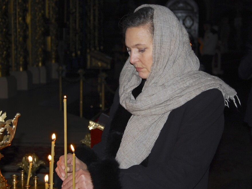 Victoria Nuland, the U.S. assistant secretary of state, lights a candle in St. Michael Cathedral in Kiev, Ukraine, on Thursday. Her comments during a leaked phone call have sparked a diplomatic row.
