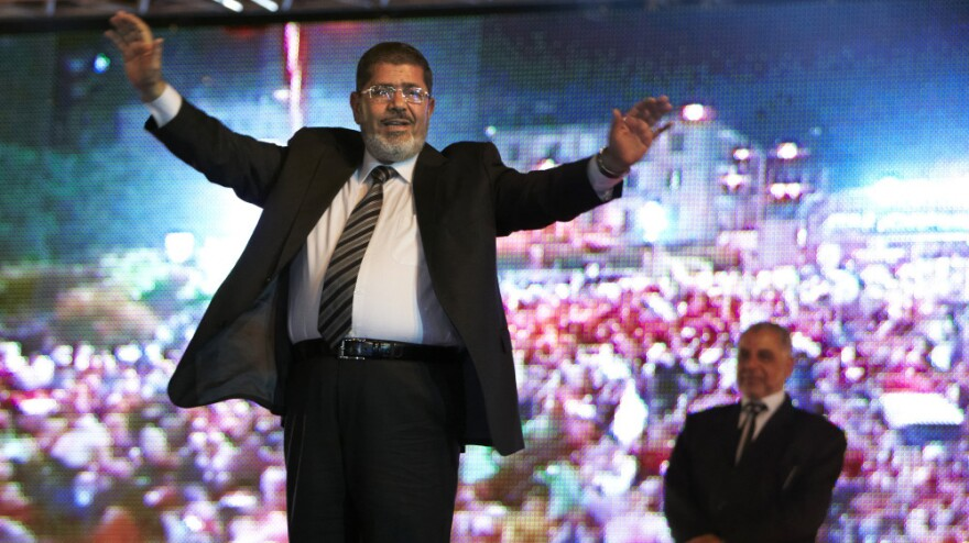 Mohammed Morsi, the Muslim Brotherhood's presidential candidate, appears at a rally in Cairo. Morsi is one of 12 candidates in this week's election and has the full backing of the powerful Islamist group.