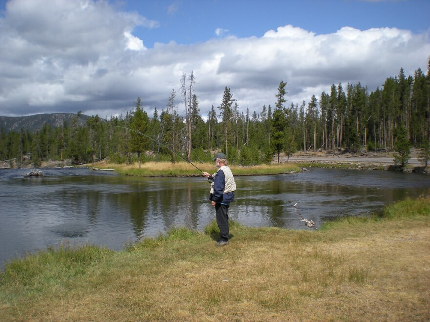 a photo of a man fishing