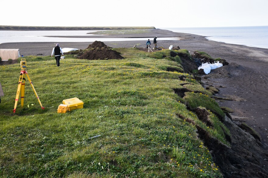In the past few years, severe storms have ripped off big chunks of the Alaska coastline. The white bags are used to try to prevent the ancient log cabin from sliding into the sea.