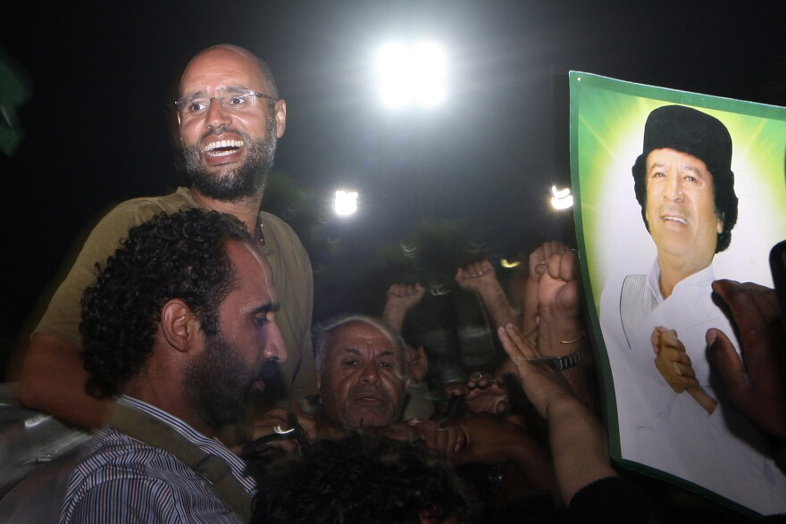 Saif Al-Islam Gadhafi greets troops loyal to his father, Moammar Gadhafi, in Tripoli, Libya, on Aug. 23, 2011.