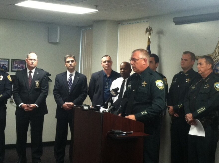 LCSO Spokesman James McQuaig speaks during a press conference on the gunfight and death of Deputy Christopher L. Smith