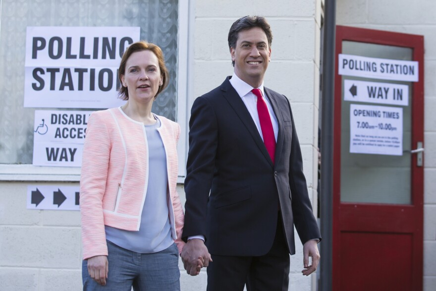 Labour Party leader Ed Miliband and his wife, Justine, leave the polling station after voting at Sutton Village Hall, Doncaster, England, on Thursday.