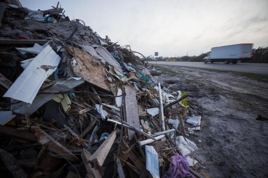 Mounds of debris from Hurricane Harvey are piled up along a two-mile stretch of Highway 35.
