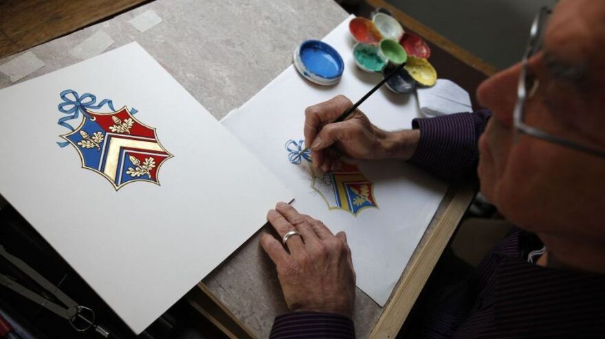 Robert Parsons sketches the new Coat of Arms for Kate Middleton's family at the College of Arms in London. The Middleton Coat of Arms features three acorn sprigs — one for each of the Middletons' children.