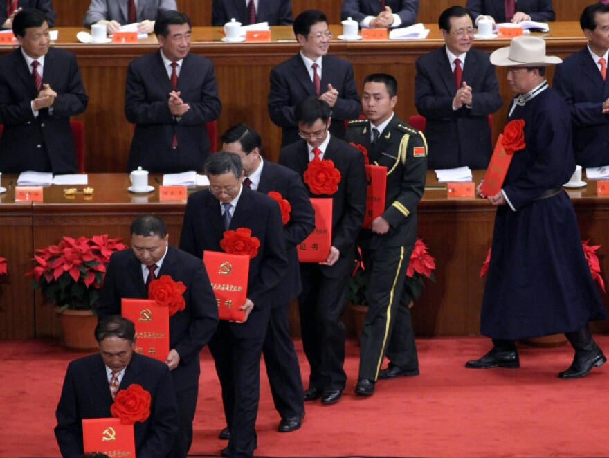 Chinese leaders award medals for outstanding members of the Communist Party during the  90th anniversary celebration in Beijing.
