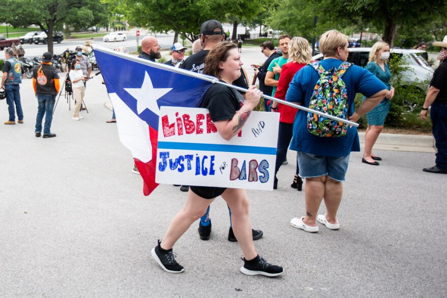 Demonstrators gather between the Texas Capitol and governor's mansion to protest the shutdown of bars in response to the coronavirus pandemic on June 30.