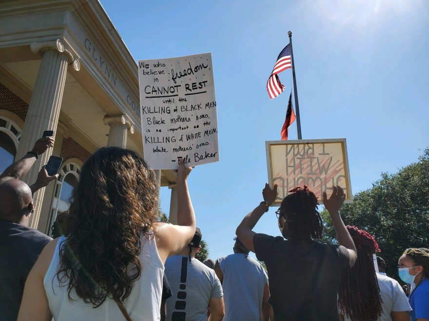 At a rally outside the Glynn County Courthouse on Friday, protesters call for justice in the death of Ahmaud Arbery.