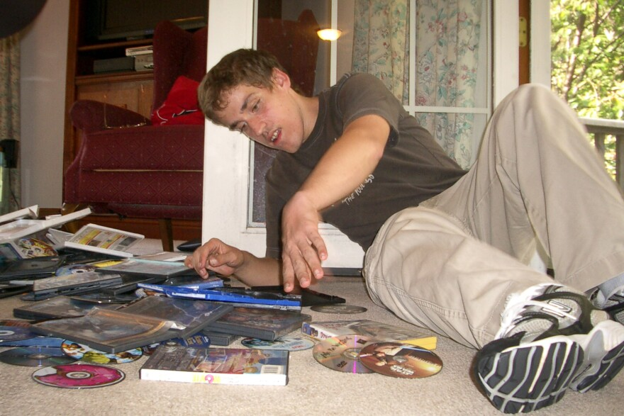 Andy in September 2010, before he began the new medication. He used to spend hours packing and unpacking videotapes and DVDs, especially when he was upset. His mother says he does that much less now.
