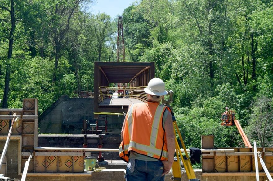 A construction worker helps build one portion of a bridge along the extended Goshen Trail in May 2019.