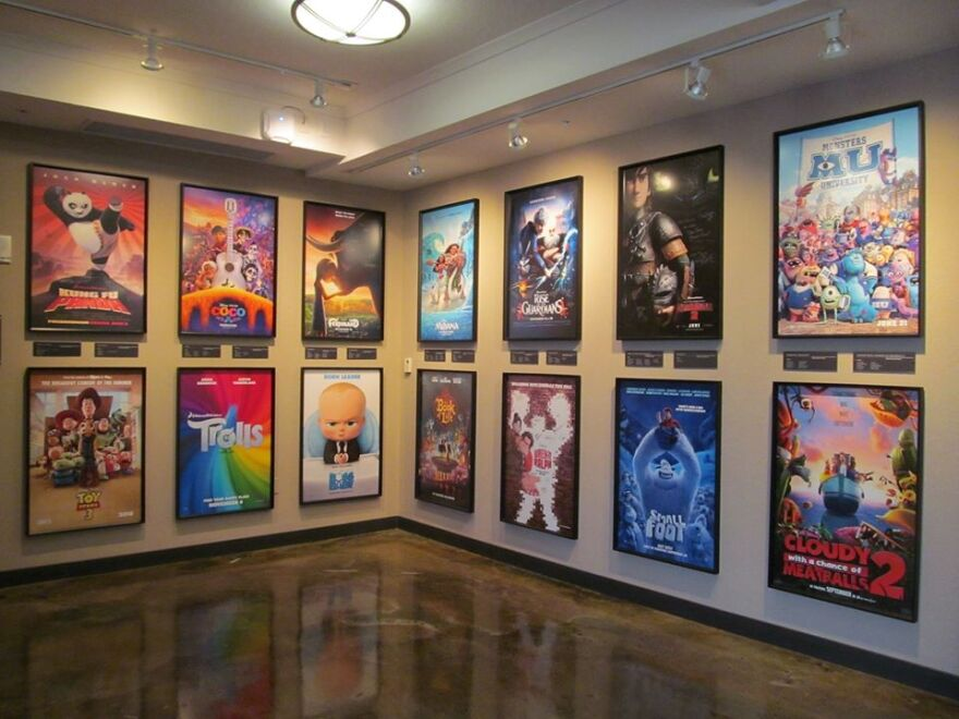 Framed movie posters hang on a wall