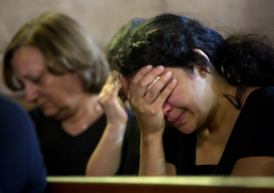 Coptic Christians grieve during prayers for the departed, remembering the victims of EgyptAir flight 804 at Al-Boutrossiya Church in Cairo, Egypt on Sunday.