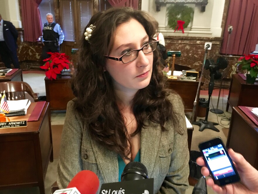 "Alderman Megan Green speaks to reporters after Friday's Board of Aldermen meeting. The 15th Ward Democrat alleged that ""bribes"" were offed by a proponent of a riverfront stadium."