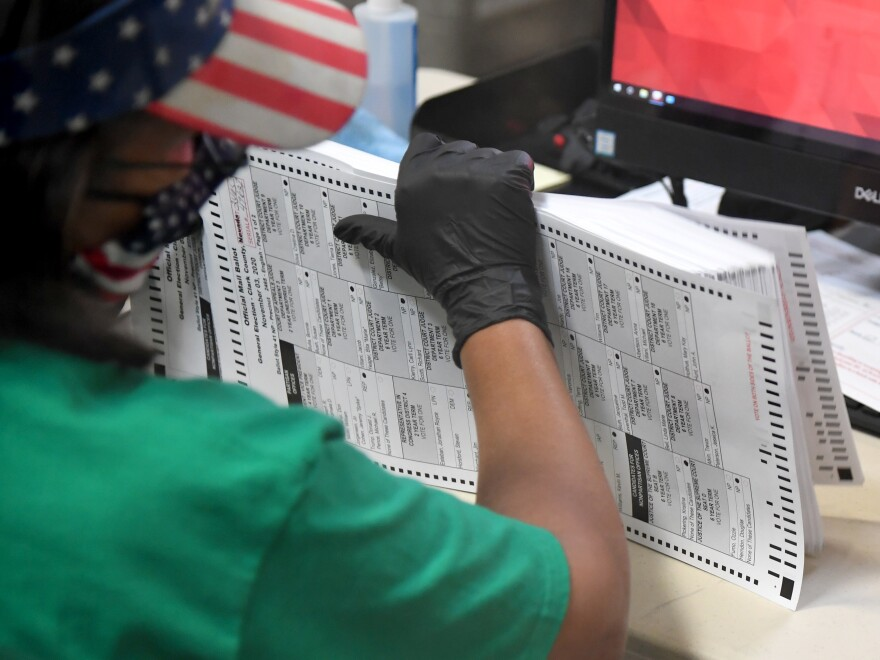 A Clark County election worker scans mail-in ballots on Nov. 7, 2020 in North Las Vegas, Nevada.