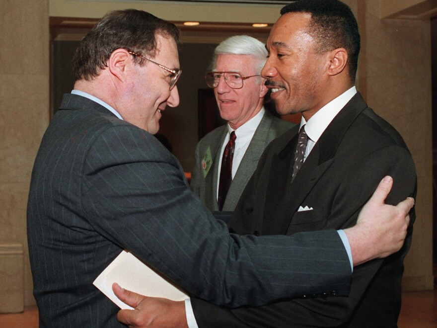 "NAACP President and Chief Executive Officer Kweisi Mfume (right) embraces Anti-Defamation League National Director Abe Foxman in Washington prior to an April 22, 1996, discussion titled ""Black/Jewish Relations and the Future of the East Civil Rights Movement."" Foxman led the ADL from 1987 to 2015."