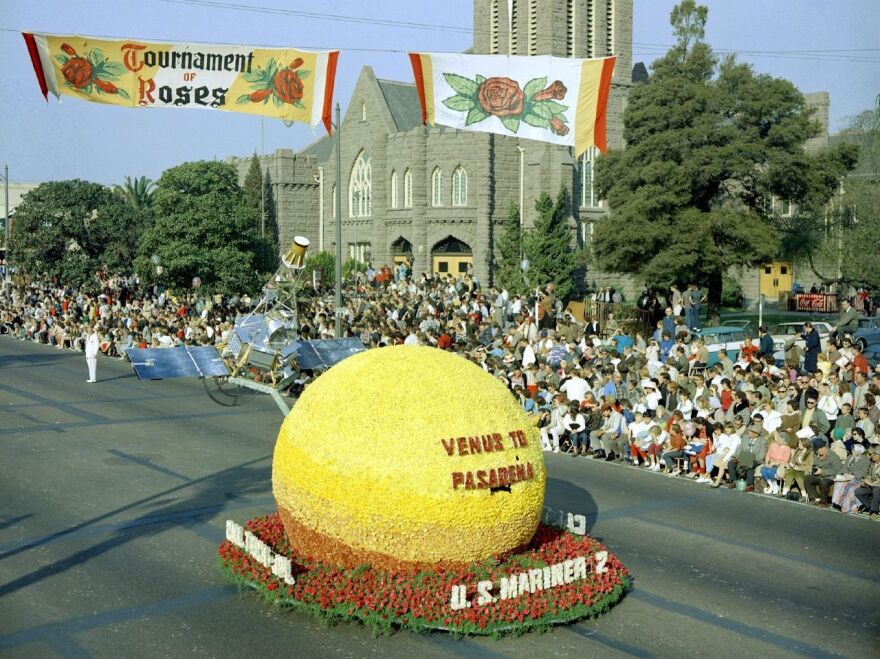 """A model of JPL's Mariner 2 spacecraft above a floral """"Venus"""" moved down Colorado Boulevard in Pasadena, Calif., in the 1963 Tournament of Roses Parade on Jan. 1."""