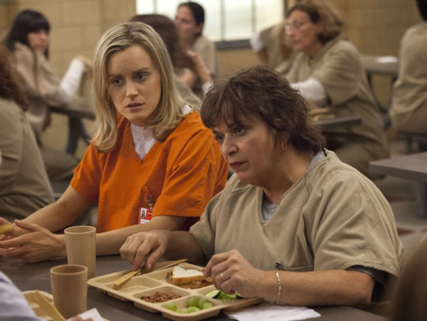 Taylor Schilling and Lin Tucci in the Netflix series <em>Orange Is the New Black</em>.