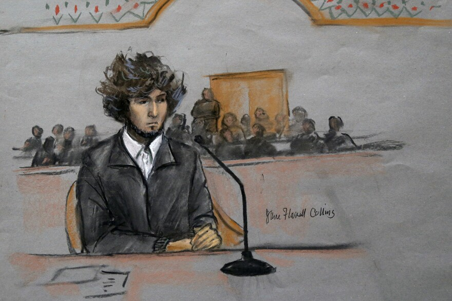 In this courtroom sketch, Boston Marathon bombing suspect Dzhokhar Tsarnaev is depicted sitting in federal court for a pretrial hearing in Boston on Dec. 18. Tsarnaev is charged with the April 2013 bombing that killed three people and injured more than 260. He could face the death penalty if convicted.