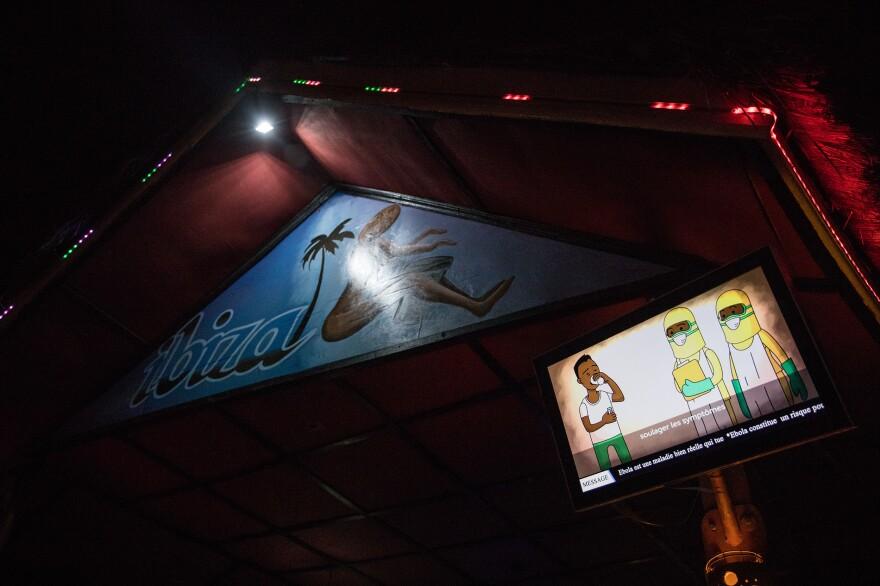 A TV screen displays an Ebola message outside Ibiza.