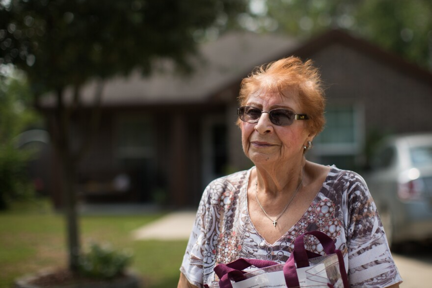 "Maria Julia Rodriguez, 73, stands in her driveway in late August and marvels at her luck. ""God was looking out for us, I guess."""