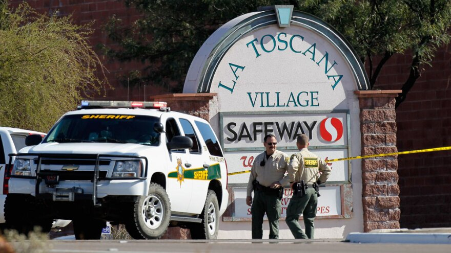 Law enforcement  officials were still trying to piece together a chronology of events and  a possible motive  for Saturday's shooting rampage at a Safeway in  Tucson, Ariz.