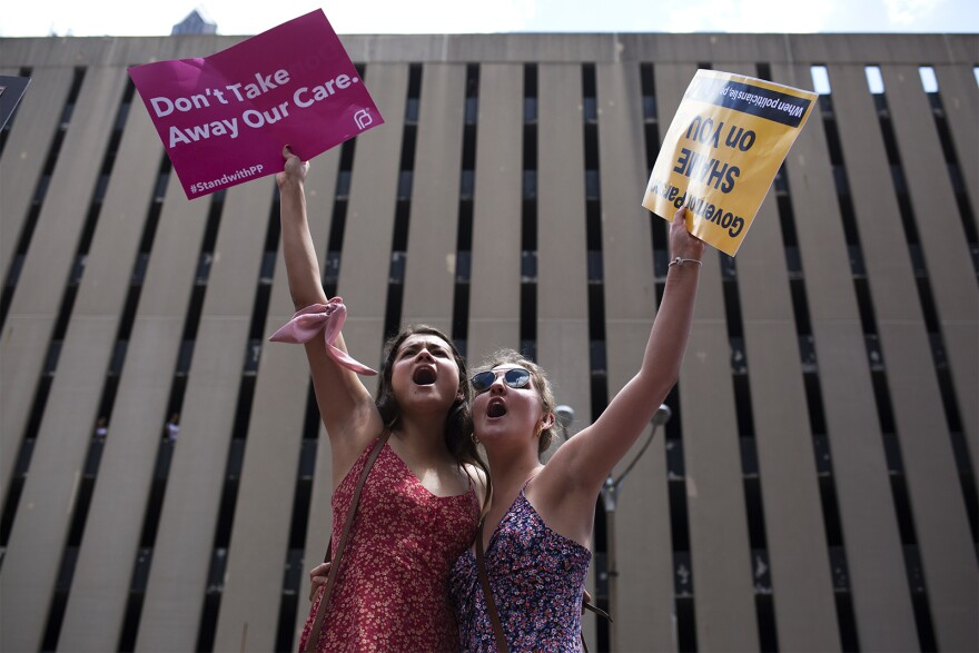 Juliana Hertel and Grace Hardison demonstrate against abortion restrictions during a Planned Parenthood rally in downtown St. Louis. May 30, 2019